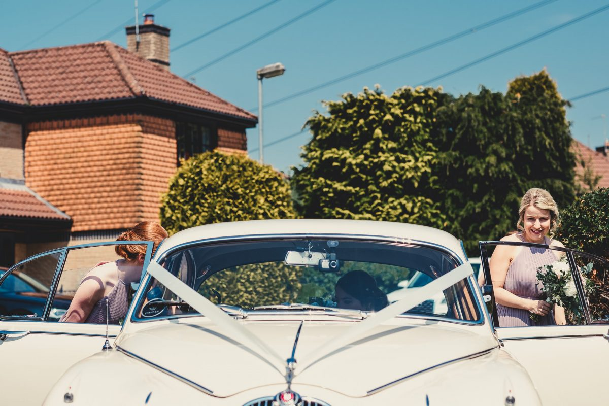 colshaw hall wedding photography, ayesha photography, manchester wedding photographer, manchester wedding photographer, cheshire wedding photographer, cheshire wedding photography, bridesmaids getting into classic jaguar wedding car