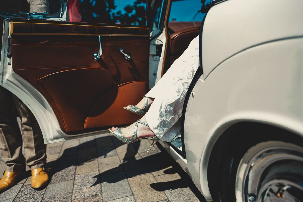 colshaw hall wedding photography, ayesha photography, manchester wedding photographer, manchester wedding photographer, cheshire wedding photographer, cheshire wedding photography, bride puts her feet out of the wedding car with Jimmy Choos on