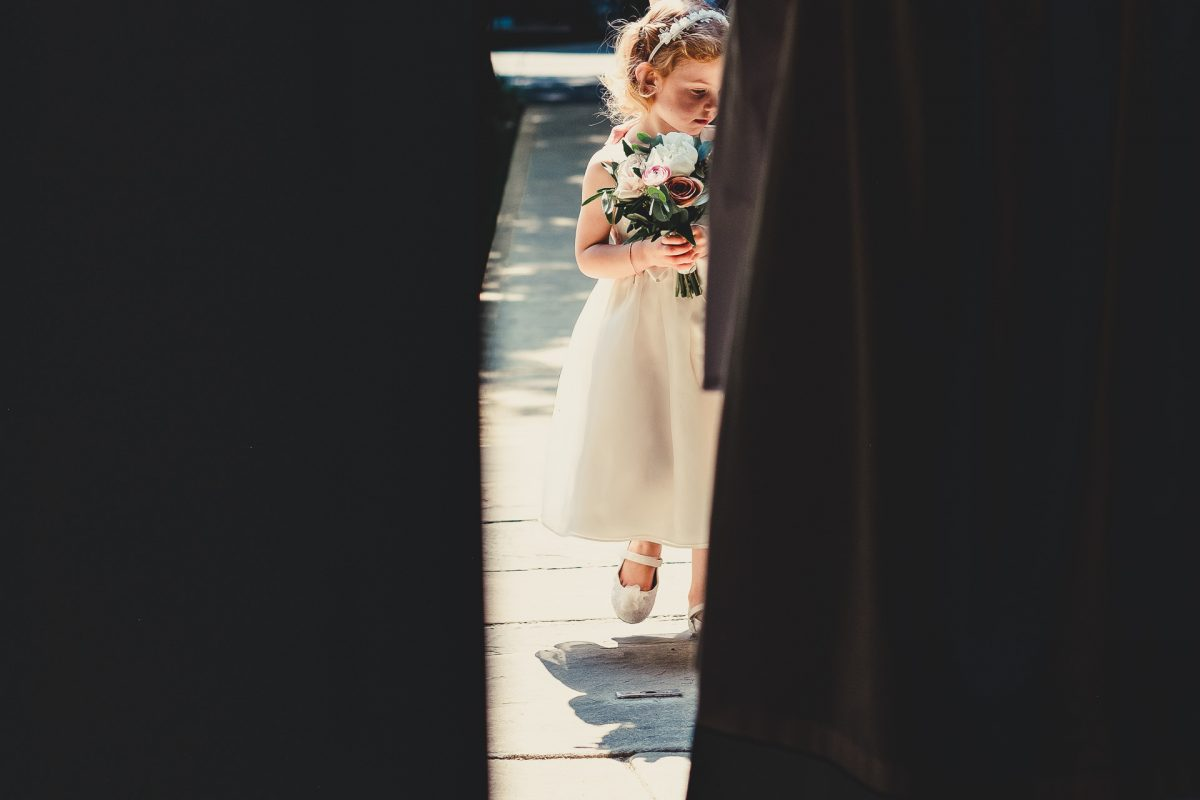 colshaw hall wedding photography, ayesha photography, manchester wedding photographer, manchester wedding photographer, cheshire wedding photographer, cheshire wedding photography, flower girl waits to walk into church