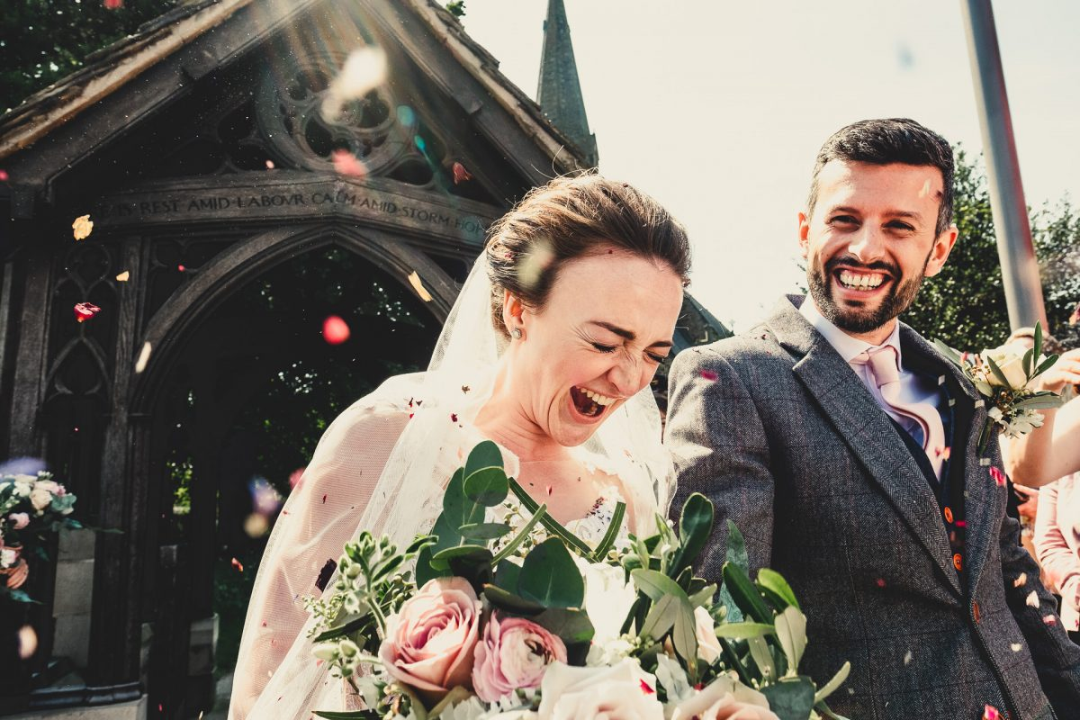 colshaw hall wedding photography, ayesha photography, manchester wedding photographer, manchester wedding photographer, cheshire wedding photographer, cheshire wedding photography, bride and groom laughing after confetti is thrown