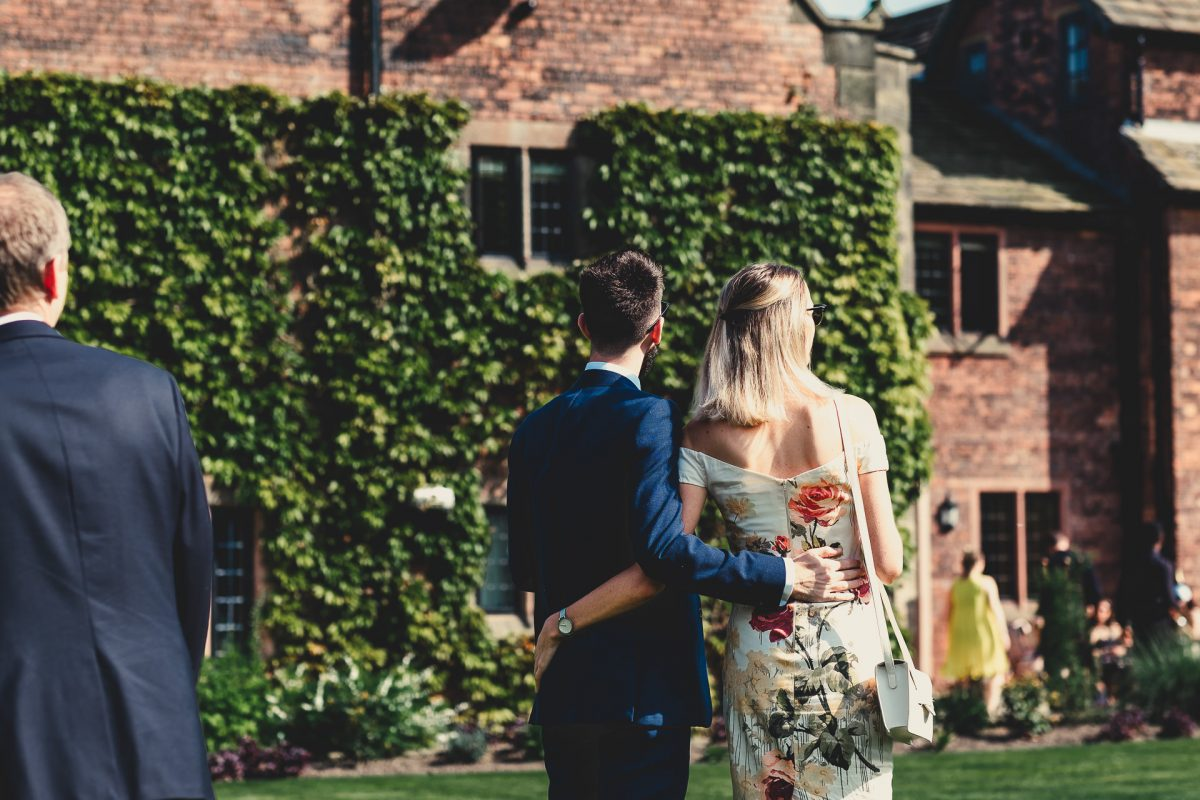 colshaw hall wedding photography, ayesha photography, manchester wedding photographer, manchester wedding photographer, cheshire wedding photographer, cheshire wedding photography, a couple watch on at a wedding