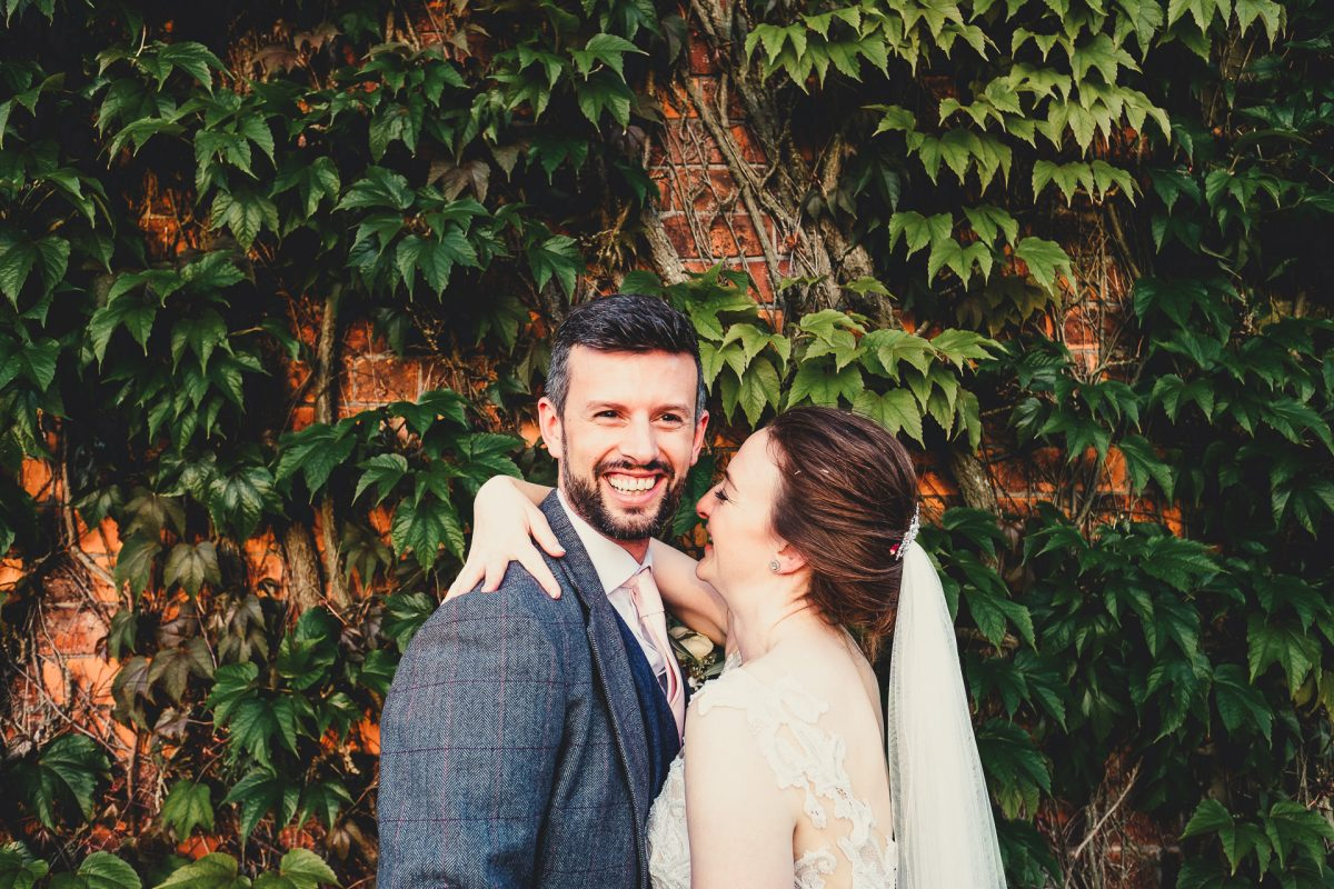 colshaw hall wedding photography, ayesha photography, manchester wedding photographer, manchester wedding photographer, cheshire wedding photographer, cheshire wedding photography, groom laughing whilst hugging bride and colshaw hall