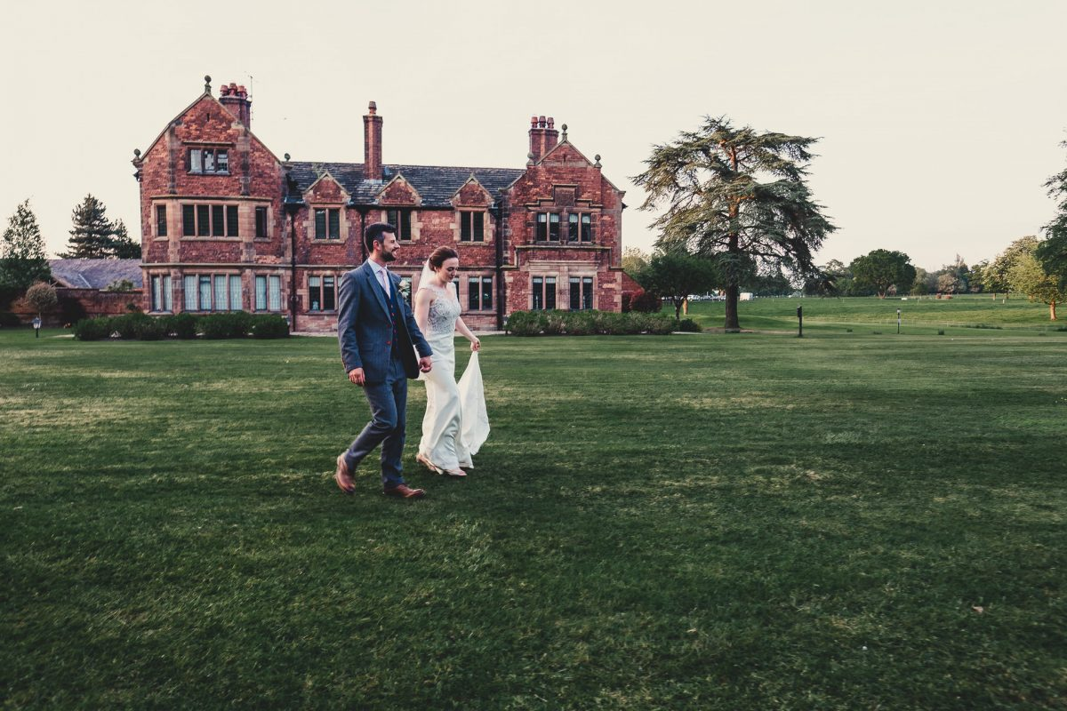 colshaw hall wedding photography, ayesha photography, manchester wedding photographer, manchester wedding photographer, cheshire wedding photographer, cheshire wedding photography, bride and groom walking in front of colshaw hall