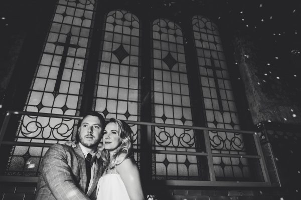 ayesha photography, manchester wedding photography, manchester wedding photographer, albert hall wedding photographer, albert wedding photography, albert hall manchester, albert hall, manchester city centre wedding, manchester city centre wedding, black and white picture of the bride and groom in front of the stained glass window at albert hall