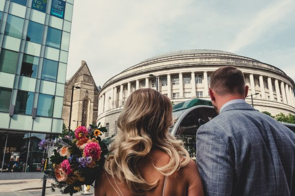 ayesha photography, manchester wedding photography, manchester wedding photographer, albert hall wedding photographer, albert wedding photography, albert hall manchester, albert hall, manchester city centre wedding, manchester city centre wedding, bride and groom wait to cross the road in front of central library in manchester