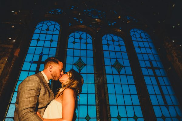 ayesha photography, manchester wedding photography, manchester wedding photographer, albert hall wedding photographer, albert wedding photography, albert hall manchester, albert hall, manchester city centre wedding, manchester city centre wedding, bride and groom kiss in front of the stained glass window at albert hall