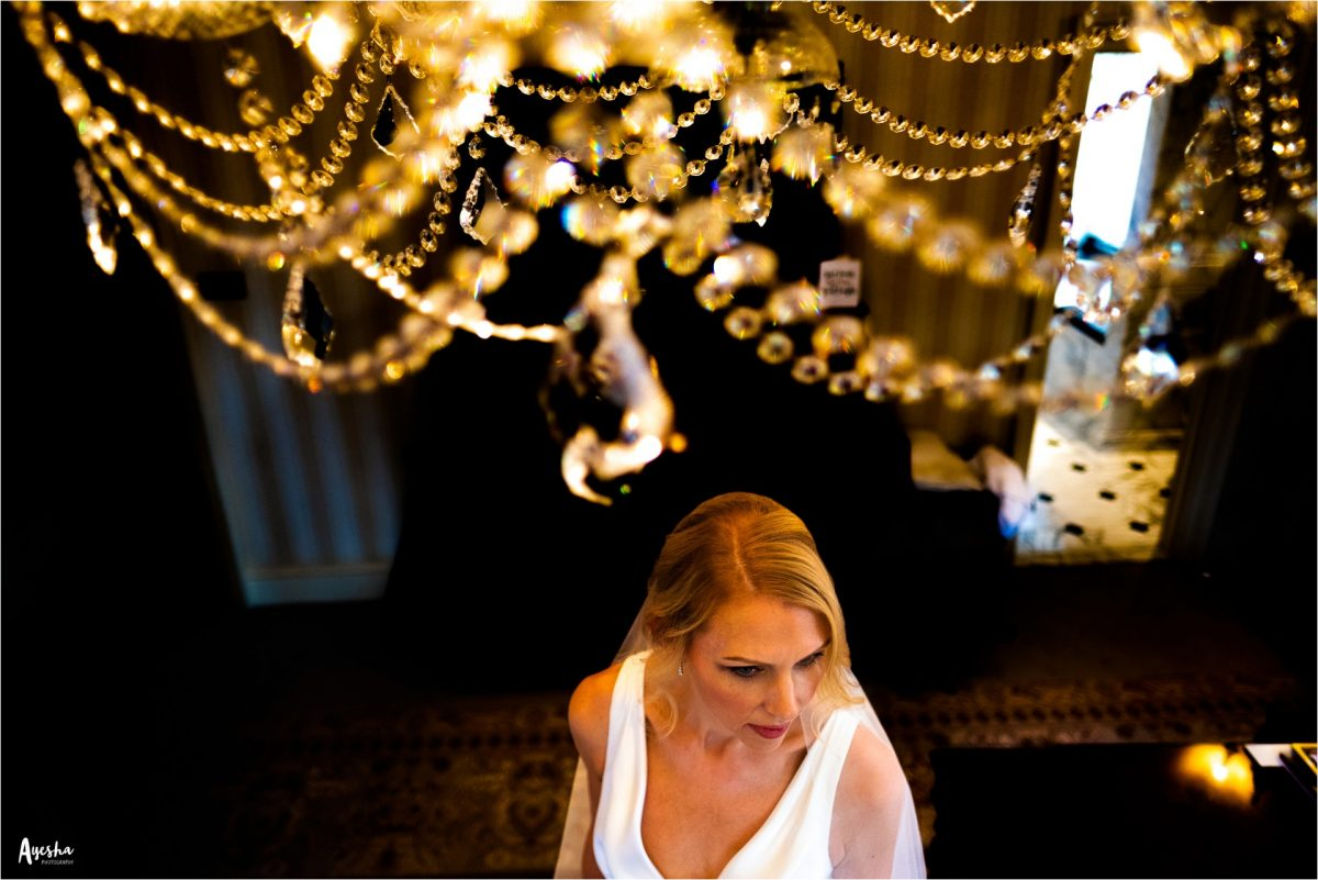 lucknam park wedding photographer, lucknam park wedding photography, lucknam park hotel and spa, lucknam park wedding, cotswolds wedding photographer, cotswolds wedding photography, lucknam spa and hotel wedding photographer, manchester wedding photographer, manchester wedding photography, ayesha photography, autumn wedding, rainy wedding photography, bride stands under chandelier