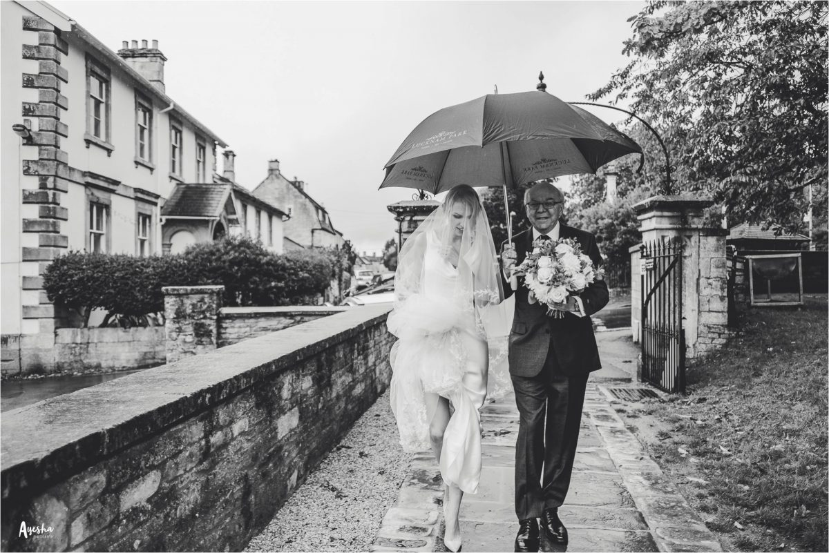 lucknam park wedding photographer, lucknam park wedding photography, lucknam park hotel and spa, lucknam park wedding, cotswolds wedding photographer, cotswolds wedding photography, lucknam spa and hotel wedding photographer, manchester wedding photographer, manchester wedding photography, ayesha photography, autumn wedding, rainy wedding photography, bride and father walk to the church under an umbrella