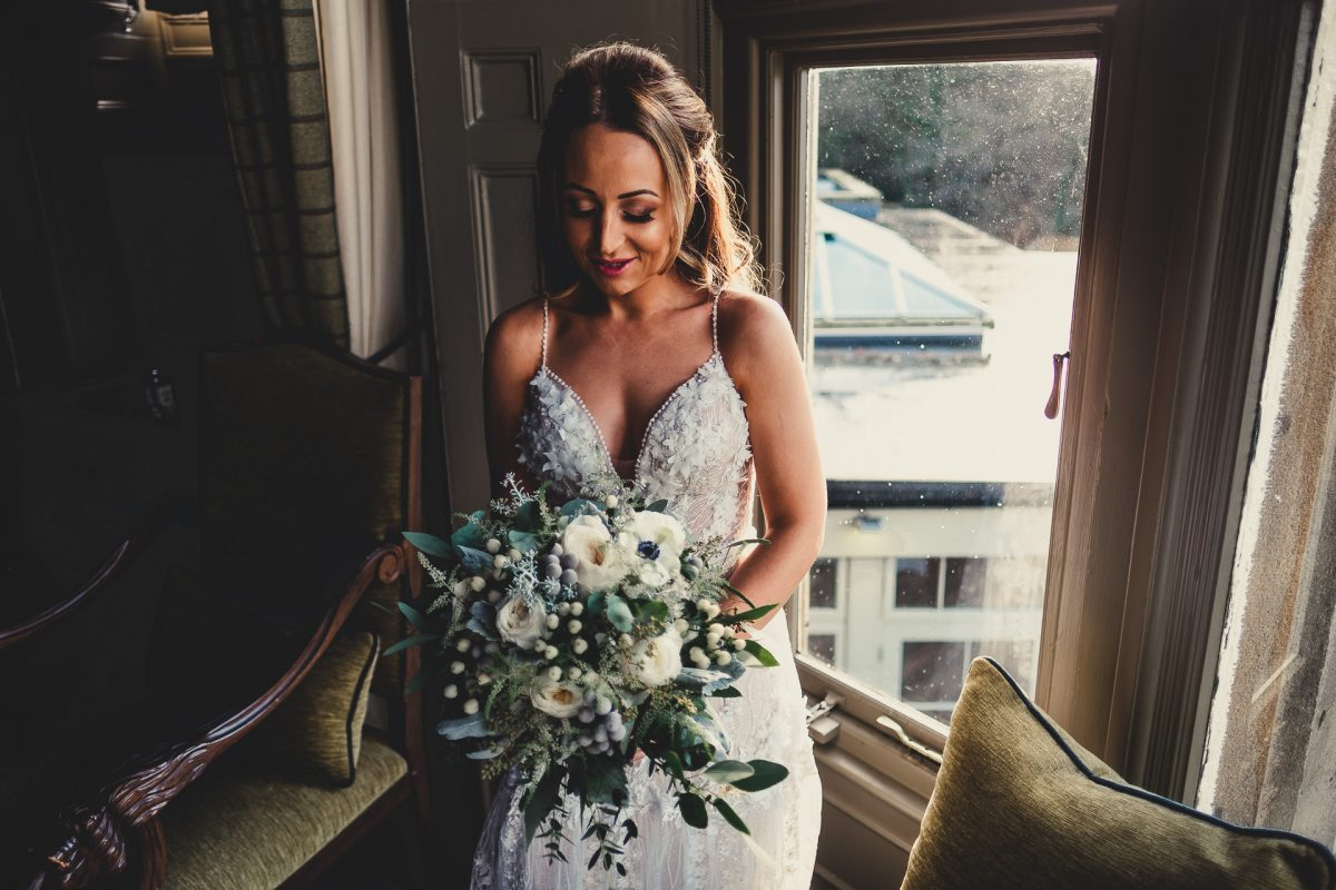 mitton hall wedding photography, mitton hall wedding photographer, mitton hall, mitton hall wedding, lancashire wedding photographer, lancashire wedding photography, manchester wedding photographer, manchester wedding photography, ayesha photography, bride looks down at her wedding bouquet