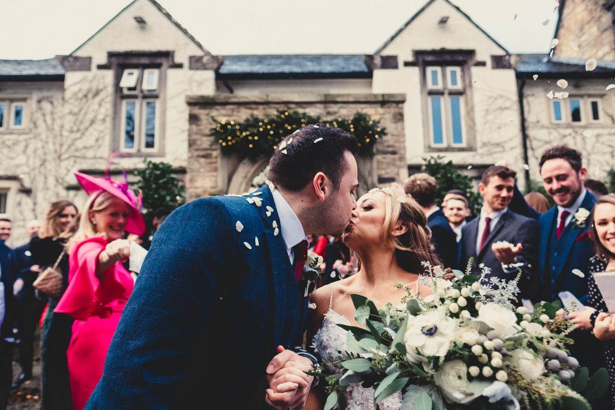 mitton hall wedding photography, mitton hall wedding photographer, mitton hall, mitton hall wedding, lancashire wedding photographer, lancashire wedding photography, manchester wedding photographer, manchester wedding photography, ayesha photography, bride and groom have a kiss with confetti being thrown at them