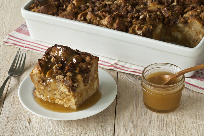Warm Pumpkin Bread Pudding with Praline Topping and Warm Rum Butter Sauce