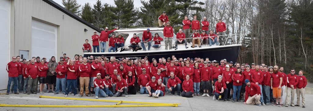 Back Cove Production Team and Associates gather with the 800th Back Cove yacht.