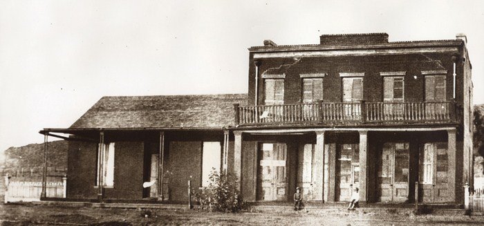 Boy sitting on porch of Whaley House