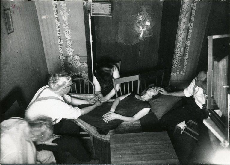 People conducting a seance