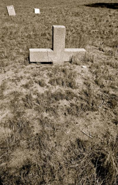 Partially Buried Headstone at Haunted Agua Mansa Cemetery in California