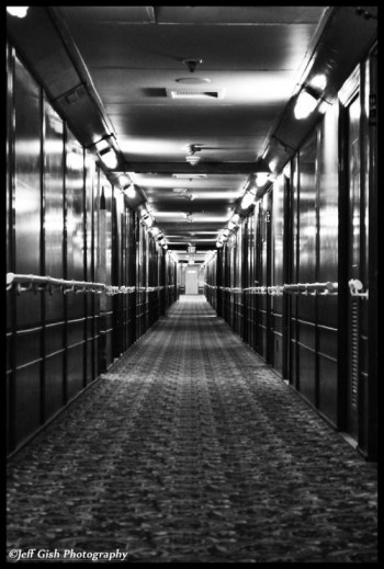 One of the many long and creepy hallways you'll see on a tour of the haunted Queen Mary ship in Long Beach California