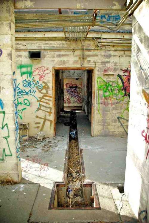 Creepy hallway of the haunted Bethany House mental hospital ruins in Highland California