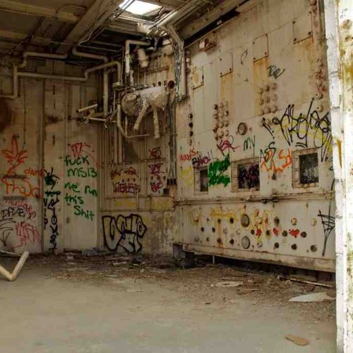 Graffiti within the confines of the haunted Bethany House mental hospital ruins in Highland California