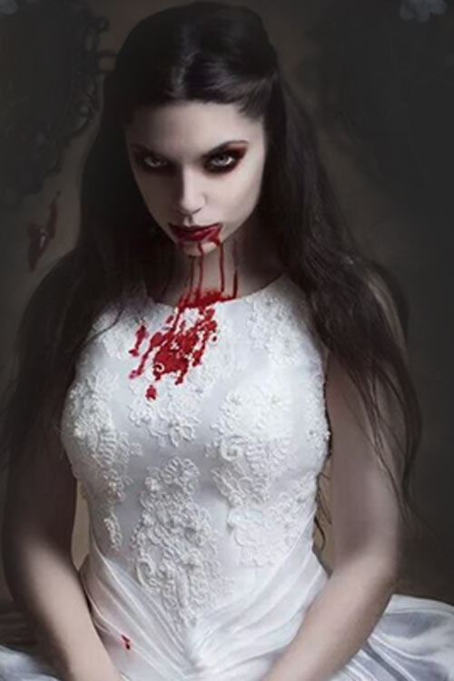 When she screams, blood shoots out of her mouth and stains her pretty dress.