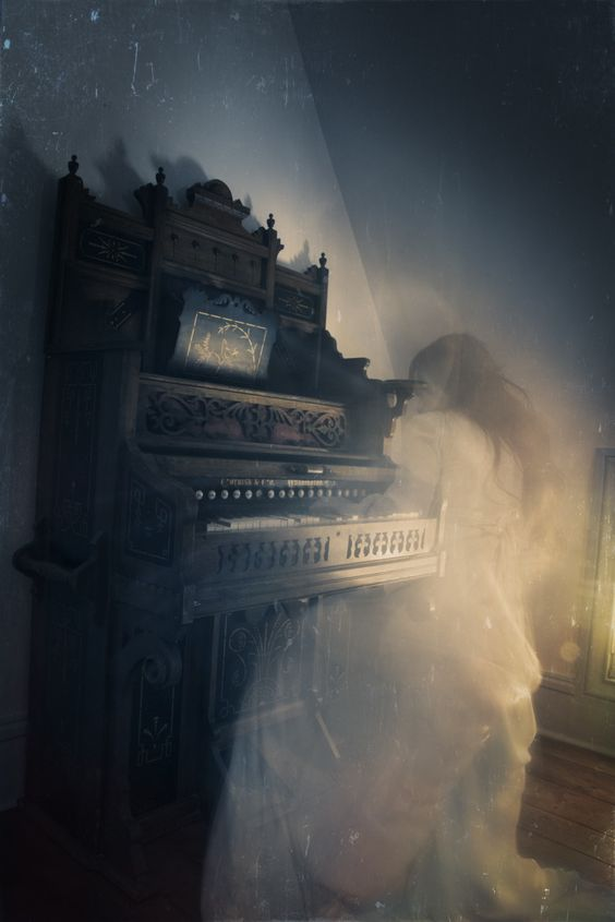She sat at the piano, playing a familiar tune...then she vanished back to wherever she came from.
