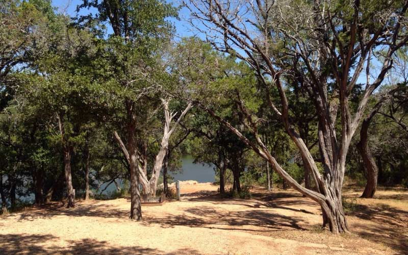 Inks Lake in Burnet is hands-down (or severed) one of the most haunted places in Texas. Cross our hearts.