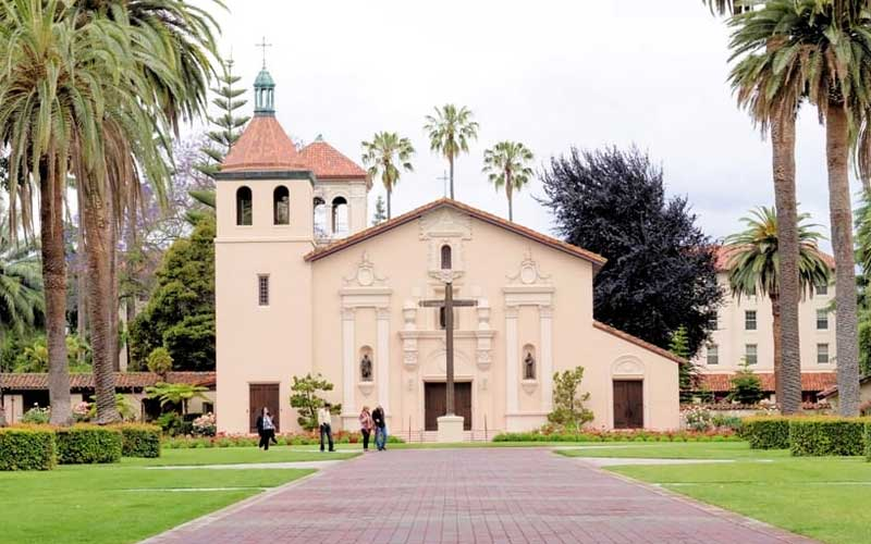 Santa Clara University in California has a strong spiritual presence, especially near the church and the gardens.