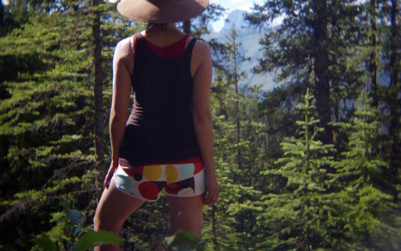 A woman enjoys the beautiful view on a hiking trip - How To Stop Chafing Between Your Buttocks When You Hike