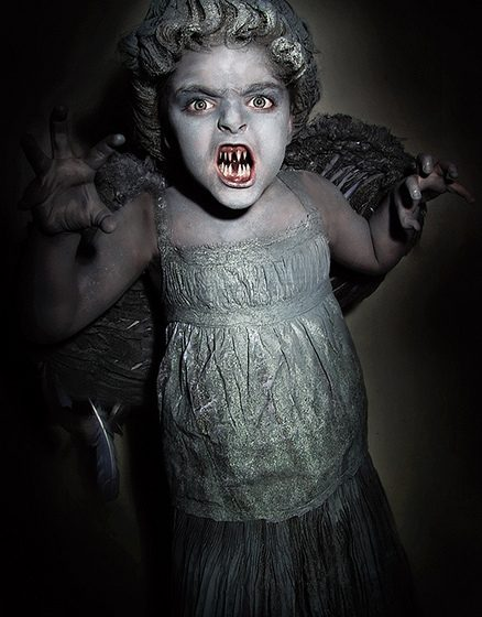 Scary Little Angel With Pointed Teeth