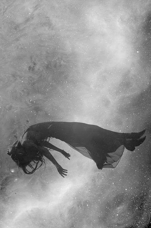 A dead girl floating in water.