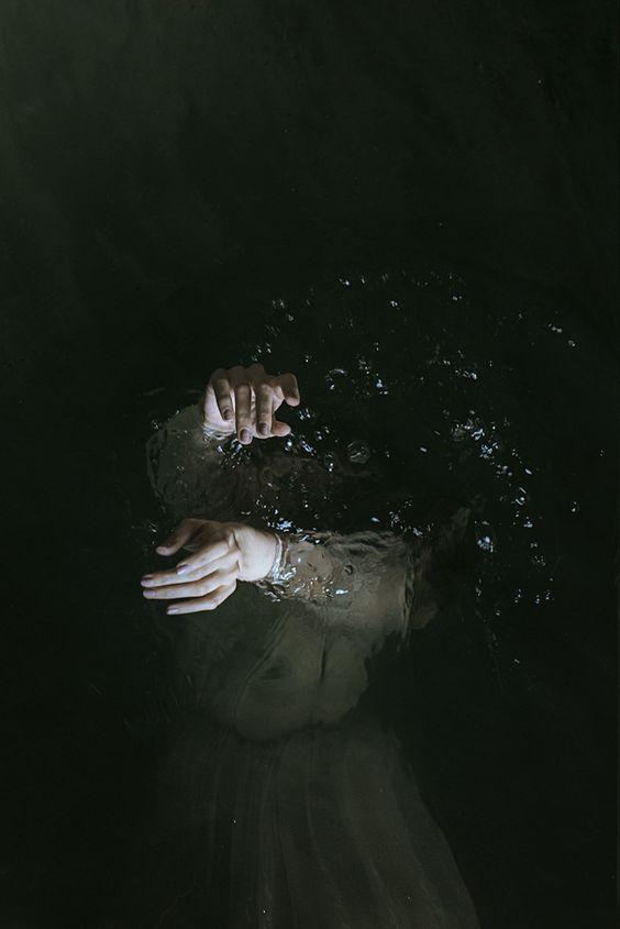Dead Woman in Water raising her Hands
