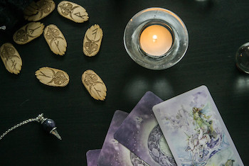 Psychics use tarot cards, runes, and crystals to get their information.