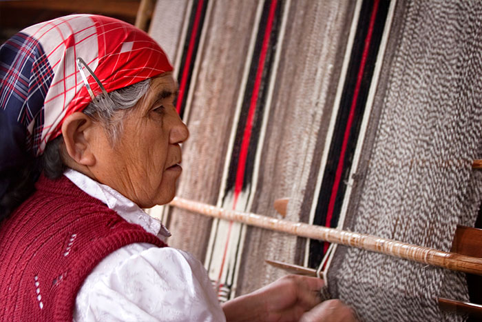 Lady weaving - Chile Family Multi-Adventure Tour