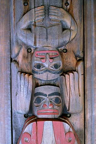 Totem carvings on a wooden fence, British Columbia, Canada