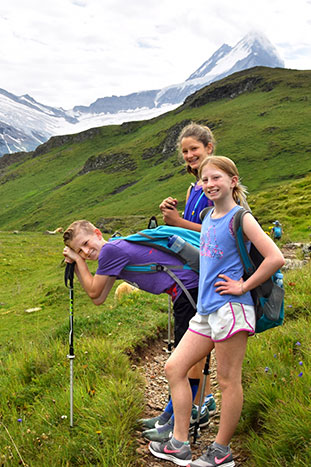 Family hiking in the Alps
