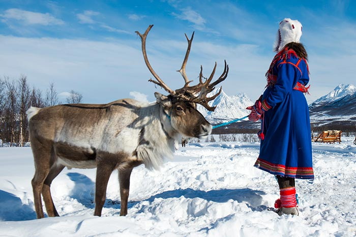 Woman and a Reindeer in Norway