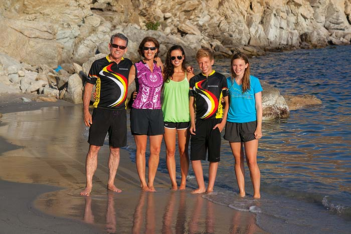 Family of cyclists on the beach in Greece