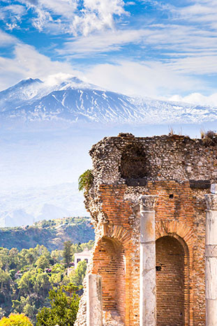 Greek Theater in Taormina Sicily, Mount Etna in the background