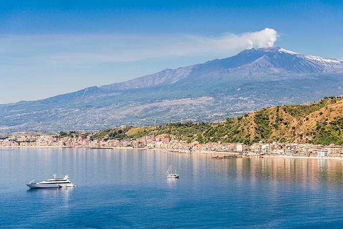 Sicily shoreline with Mount Etna in the background, Italy