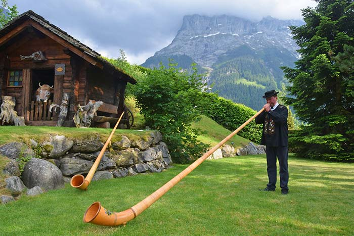 Alphorn player in Switzerland