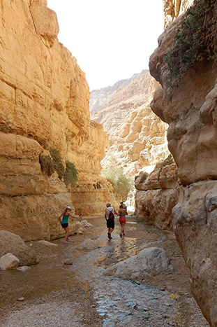 Hiking in a slot canyon on Backroads Israel and Jordan tour