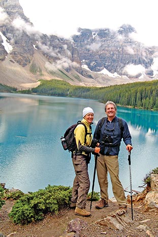 Couple hiking by a lake in the Canadian Rockies