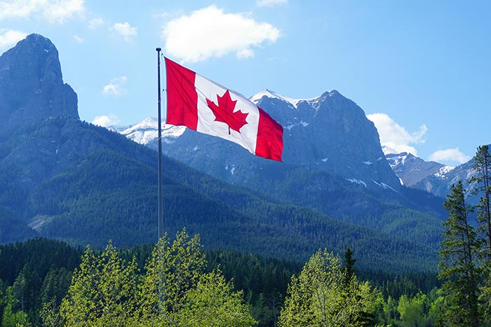 Canadian Flag flying over the Rockies