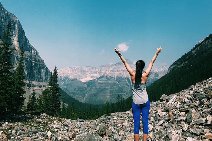 Woman Celebrating a hike in the Canadian Rockies