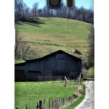 Product, Cellphone Case: At the End - Black barn at the end of a driveway with blue skies and mountain