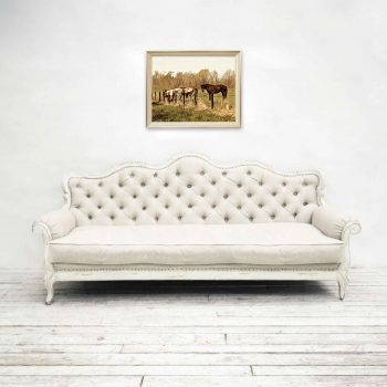 Three Amigos, horse art on wall above white tufted couch