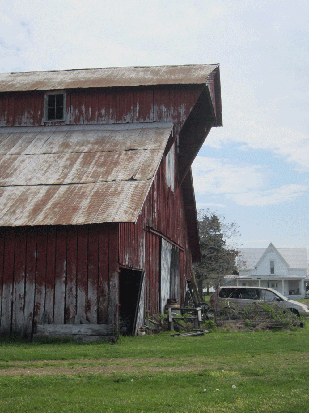 Original image of red gabled barn with rusting tin roof