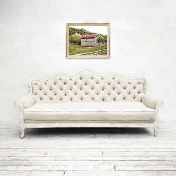 Wooden barn wall decor in living room above white couch
