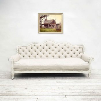Framed art: Rustic log cabin and outhouse over white farmhouse couch
