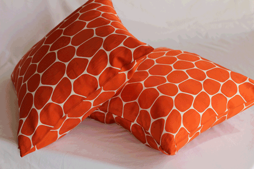 Orange and white pillows in Using Color Psychology Decorating article