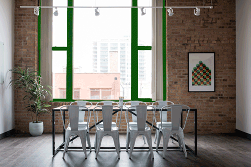 Loft space with green accents in Using Color Psychology in Decorating article